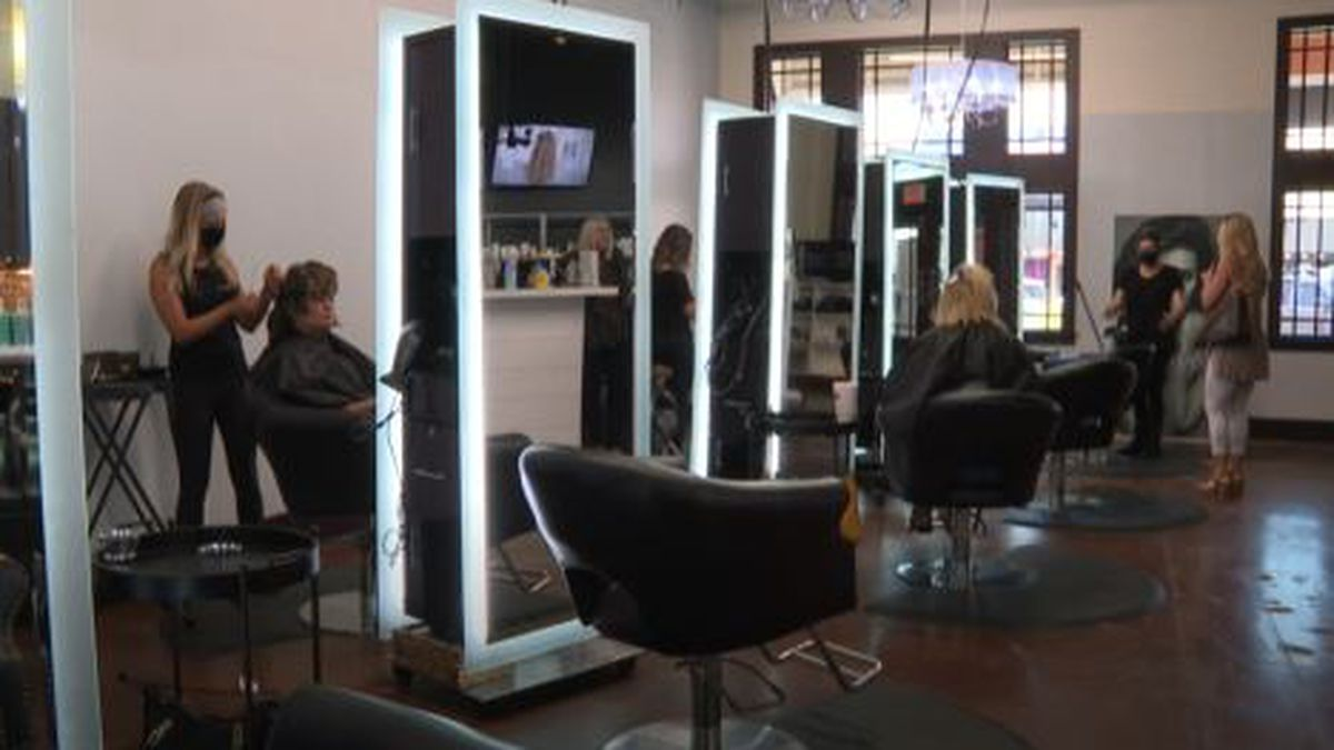 Paradigm Salon socially distances its customers after reopening their doors on Monday following the COVID-19 closure. (WJHG/WECP)