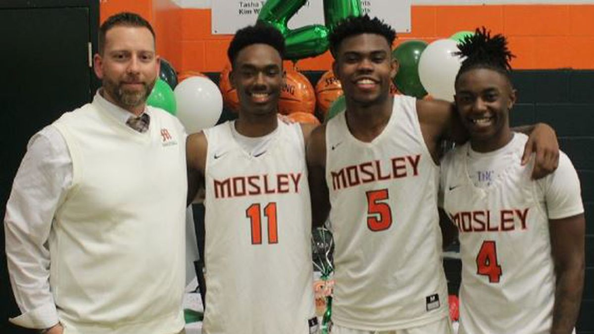 Memmen, Miller, Gibson, and Peace celebrate senior night at Mosley.