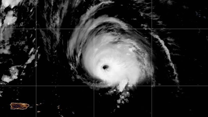 The U.S. National Hurricane Center said Sam was centered about 825 miles (1,325 kilometers)...