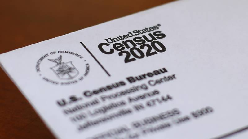 This Sunday, April 5, 2020 photo shows an envelope containing a 2020 census letter mailed to a...