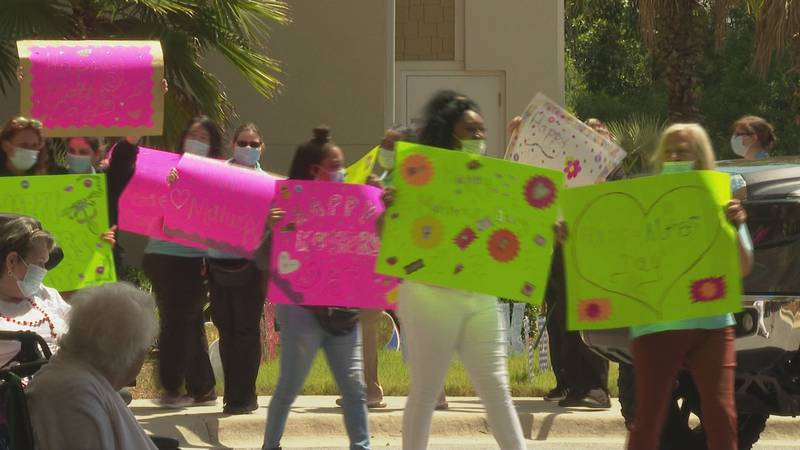 Staff members paraded around with homemade signs. (WJHG/WECP)