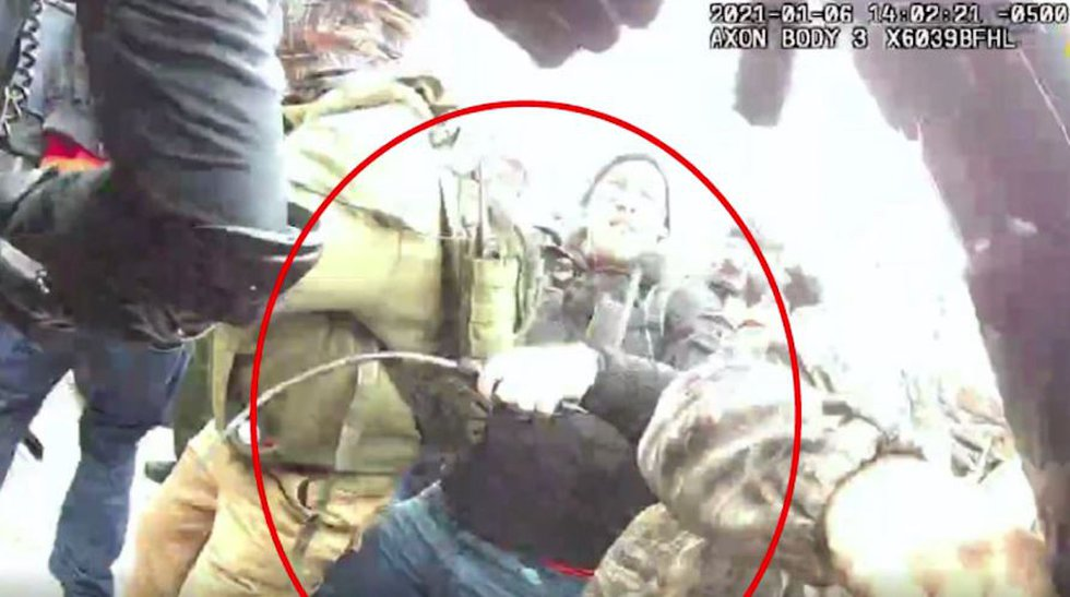 According to court filings, video footage from the Capitol riot shows Taake using pepper spray...