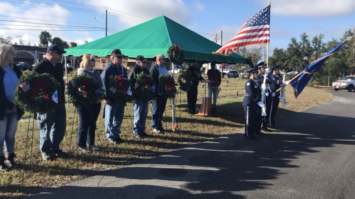 Many locals and their families came to Kent Forest Cemetery Saturday and laid 1,200 wreaths at the graves of fallen veterans.  (WJHG/WECP)