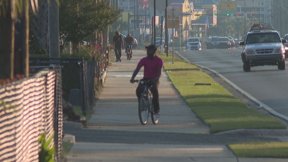 Florida man riding bicycle in a roadway. Florida leads the country in fatal bicycle accidents and locals share their thoughts on bicycle safety.<br />(WJHG/WECP)
