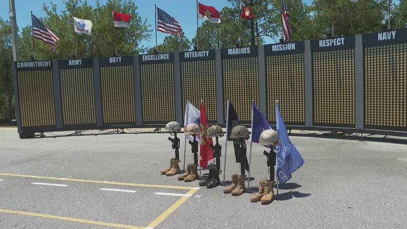Locals and visitors pay their respects to fallen servicemen and women.