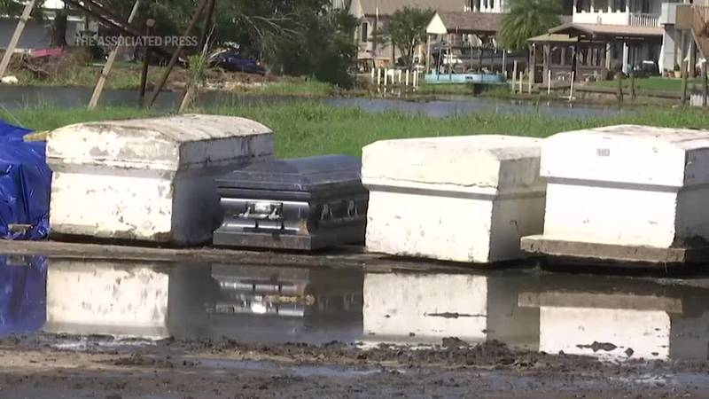 Flooding and storm surge from Hurricane Ida moved vaults and caskets out of their final resting...