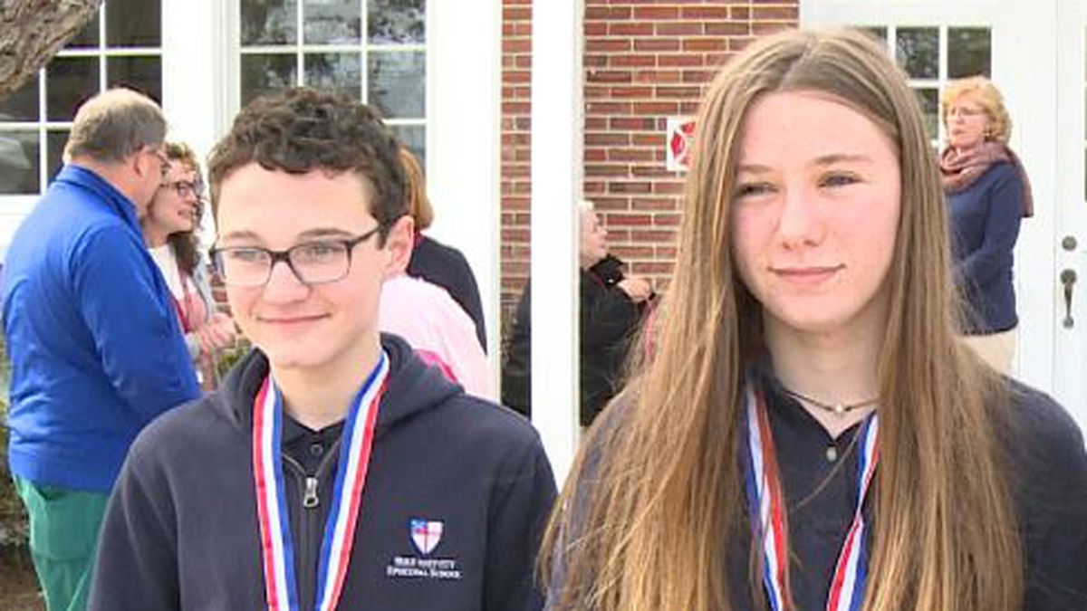 Reagan and John both received an award and a check from the VFW. (WJHG/WECP)