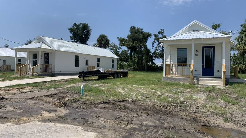 The four white houses off Wilson Avenue in Panama City are two-bedroom, two-bathroom, roughly...