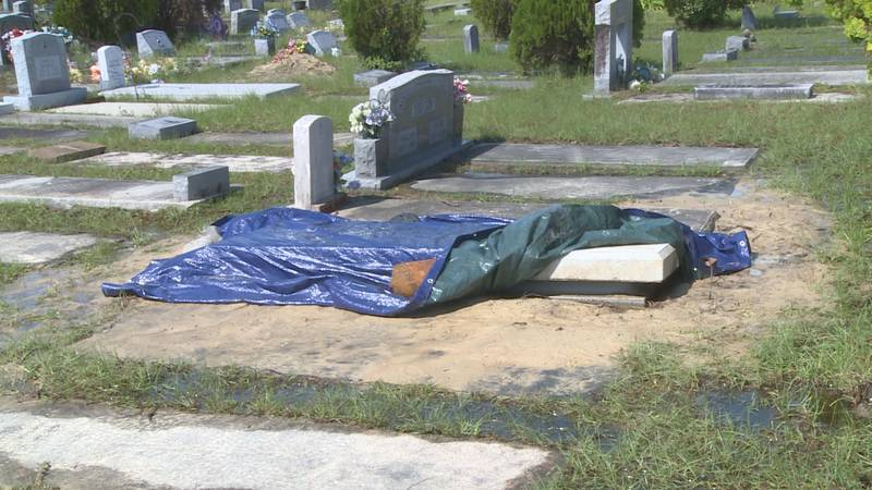 The exposed casket could be seen here Friday afternoon.