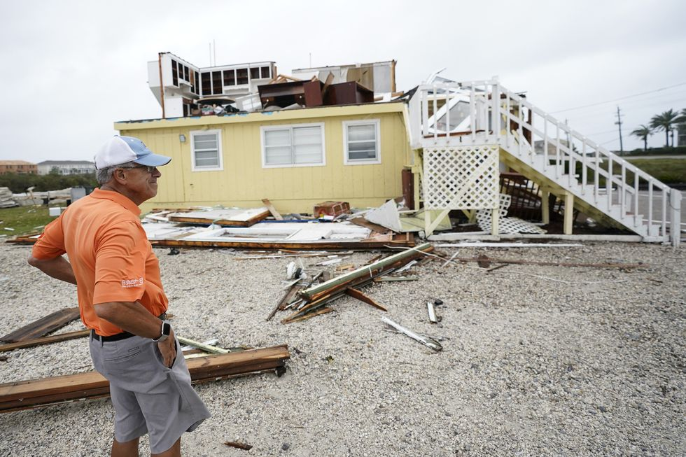 Joe Mirable surveys the damage to his business after Hurricane Sally moved through the area,...