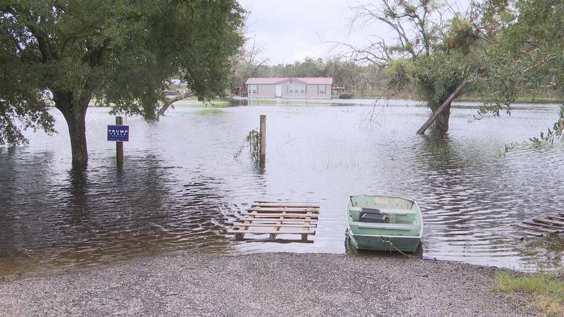 Although it may look like a pond or lake, this is the remnants of someone's yard after heavy,...