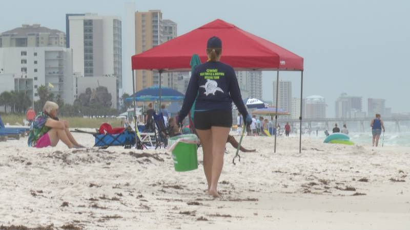 People were carrying buckets around the beach Saturday morning, but it wasn't to play in the...