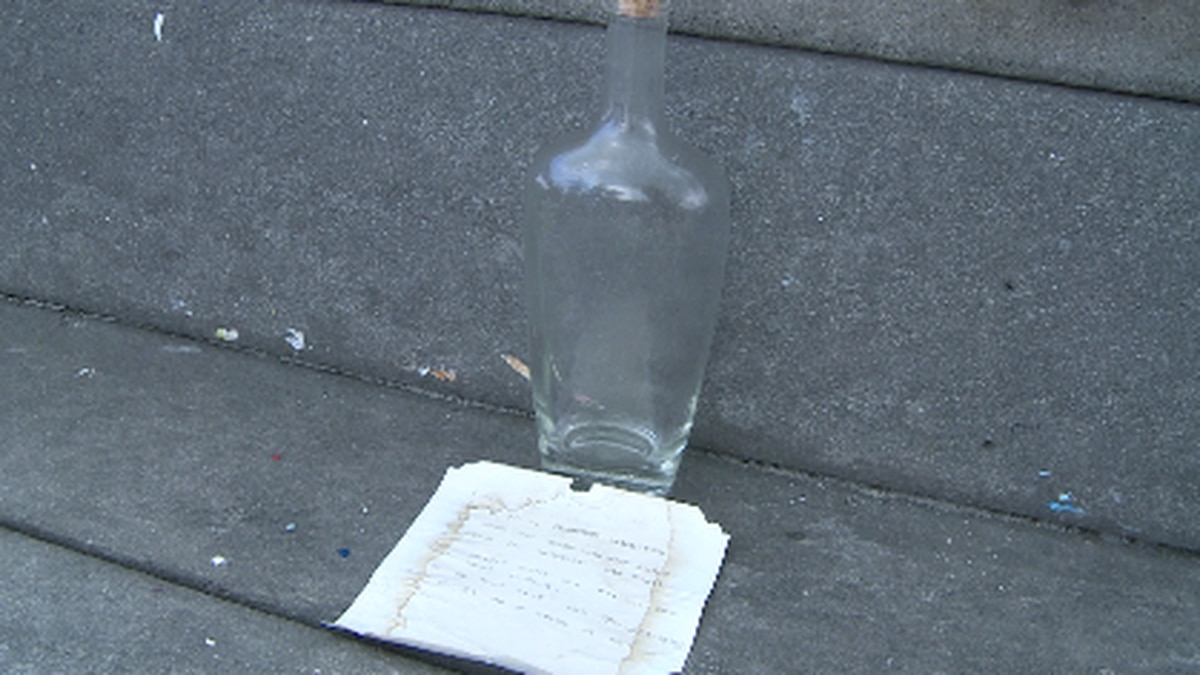 A man finds a message in a bottle in Santa Rosa Beach. (WJHG/WECP)