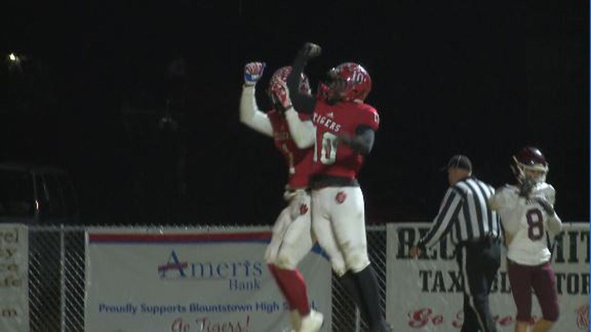 Treven Smith celebrates a first quarter touchdown catch with Pola McCloud.