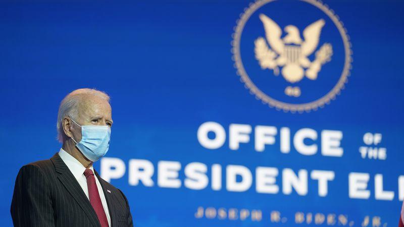 President-elect Joe Biden, accompanied by Vice President-elect Kamala Harris, prepares to speak...