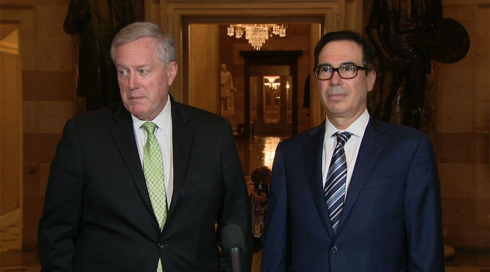 White House chief of staff Mark Meadows and Treasury Secretary Steven Mnuchin speak to reporters on Capitol Hill Thursday in Washington, DC, as ongoing talks have yet to produce an aid deal.