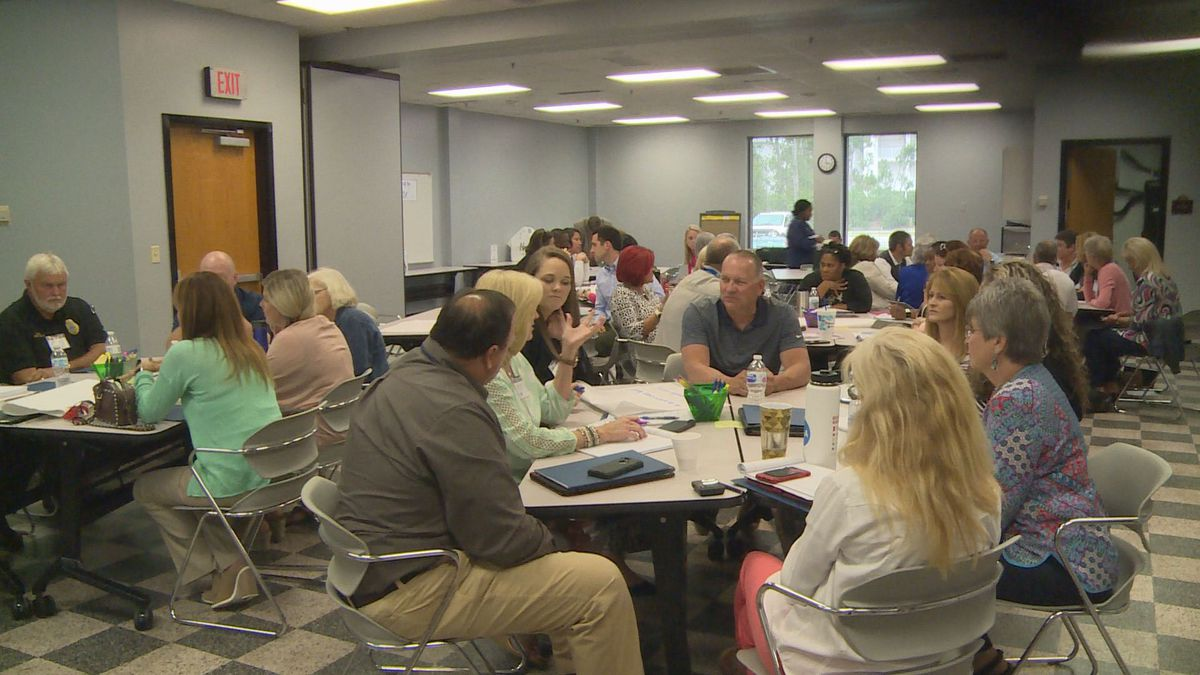 This image shows mentors and administrators at the Mentor Workshop hosted by Bay District Schools. (WJHG)