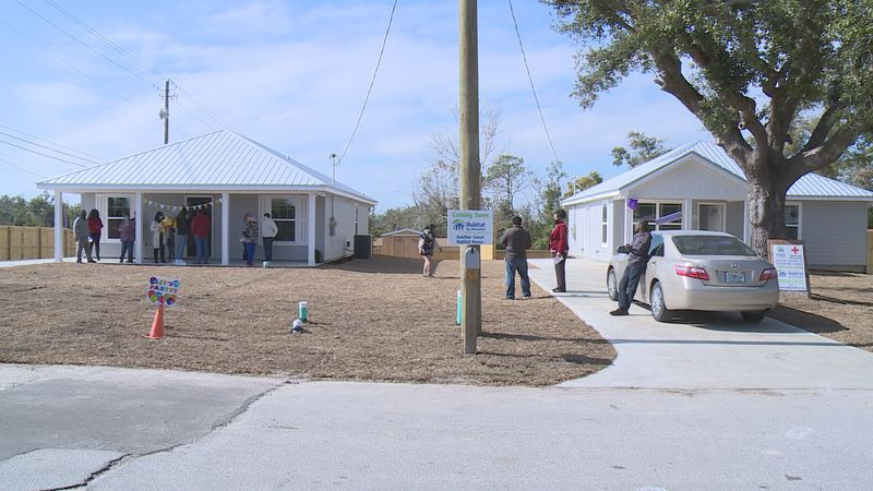 The homes were dedicated in consecutive ceremonies Thursday morning.