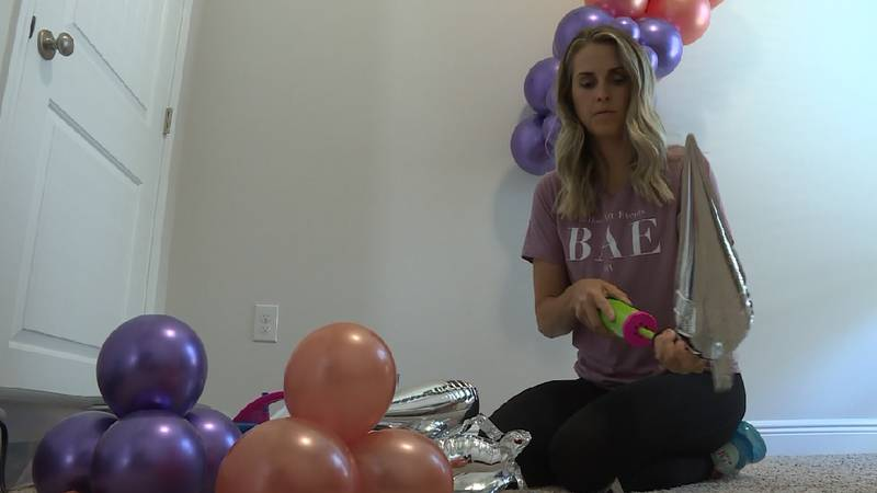 Balloon artist Megan Manchester creates a balloon arrangement out of her Panama City home.