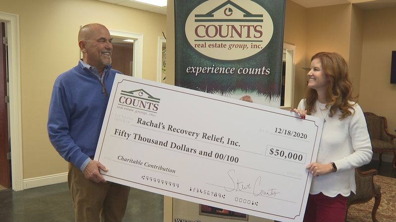 Friday, Counts Real Estate Group presented a check to Rachal's relief for $50,000 to help with...