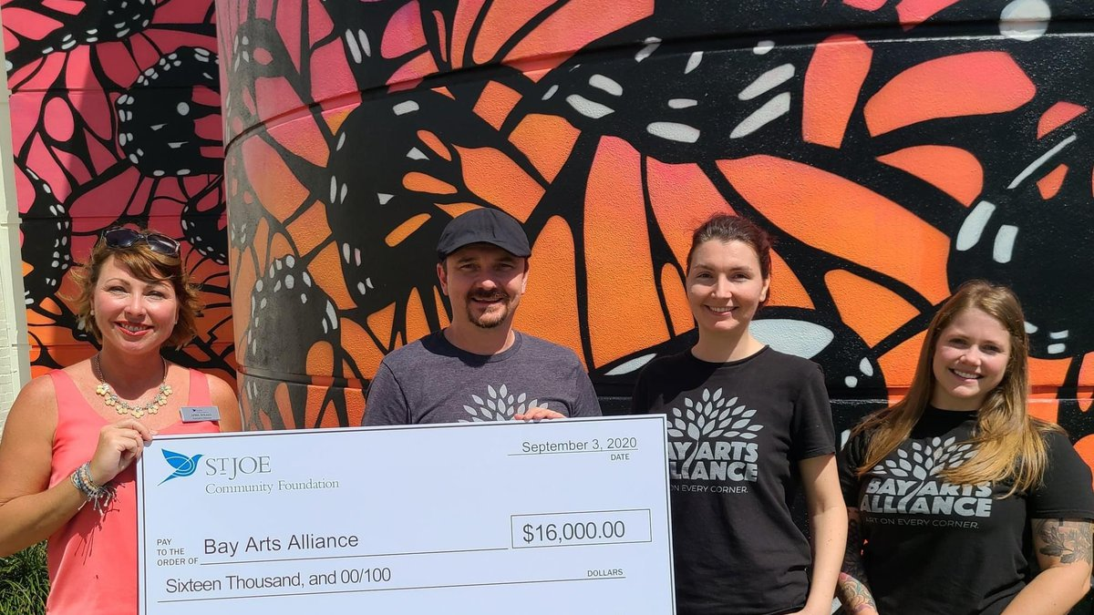 April Wilkes of the St. Joe Community Foundation presented the check to members of Bay Arts...