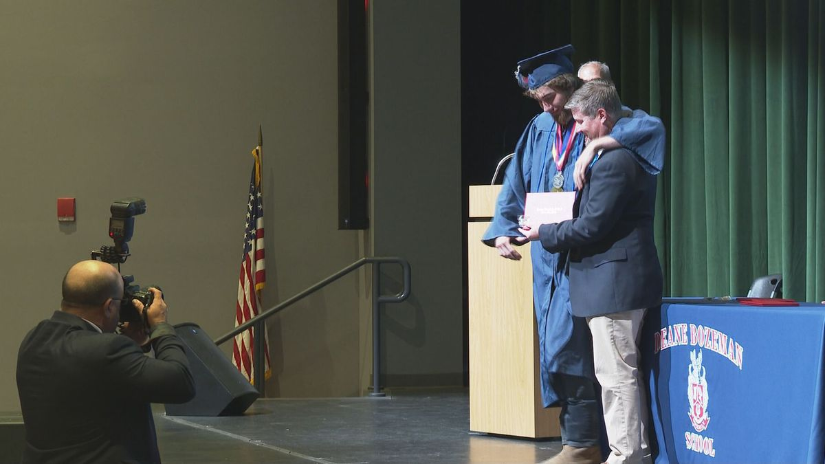 The seniors walked across the stage to receive their diploma from Principal Balkom. (WJHG/WECP)
