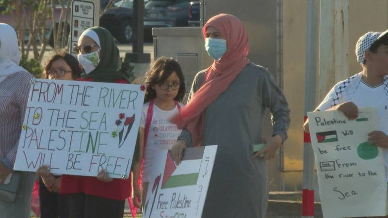 Locally several community members gathered to protest the ongoing battle between Israel and...