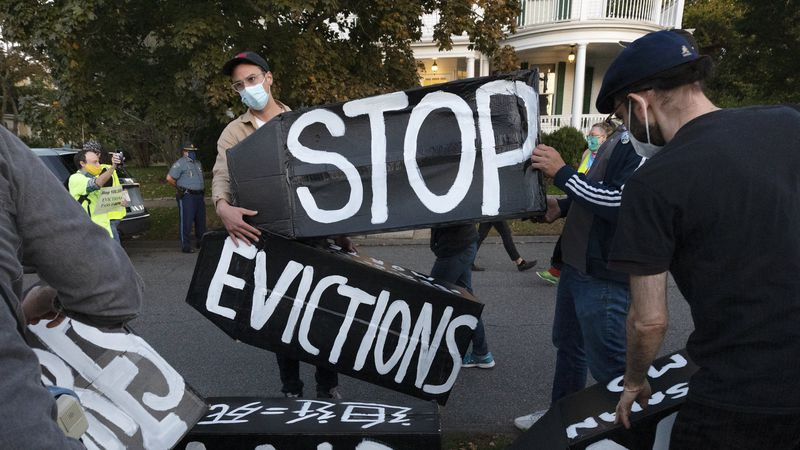 FILE - In this Oct. 14, 2020, file photo, housing activists erect a sign in front of...