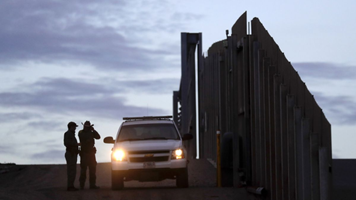 In this Wednesday, Nov. 21, 2018 file photo, United States Border Patrol agents stand by a vehicle near one of the border walls separating Tijuana, Mexico, and San Diego, in San Diego. A federal judge has ruled that a partial ban on asylum doesn't apply to anyone who appeared at an official border crossing before July 16 to make a claim, a move that could spare thousands of people. The administration said in July that it would deny asylum to anyone who traveled through another country without applying there first. The ban was on hold until the U.S. Supreme Court decided in September that it could take effect during a legal challenge. (AP Photo/Gregory Bull, File)