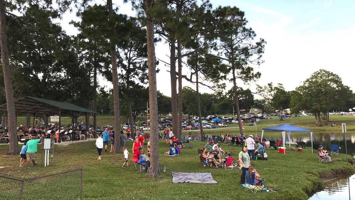 Residents stake out spots in Twin Hills Park to watch the 2019 Independence Day fireworks. This year attendees will have to practice social distancing and are asked to wear masks.