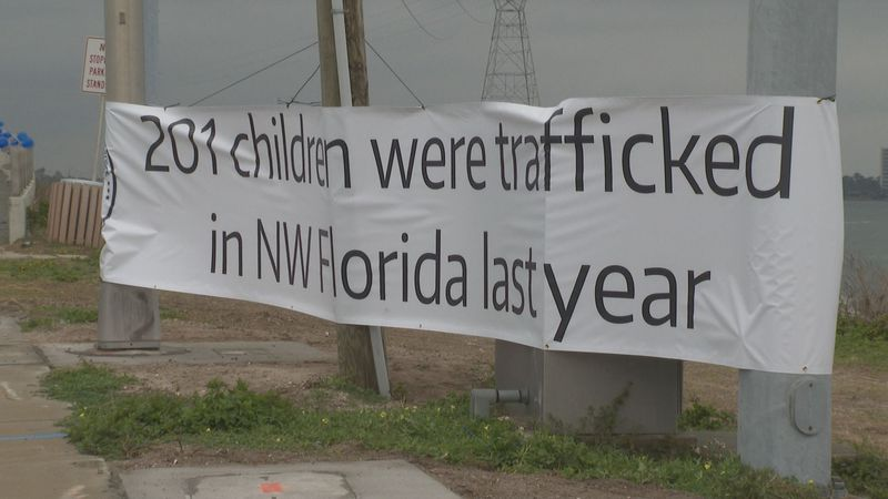 The 14th Circuit Human Trafficking Task Force hung 201 balloons along the Hathaway Bridge to...