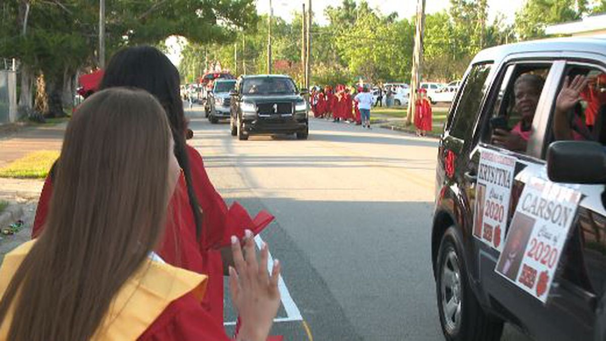 Blountstown seniors wave as cars process down Pear Street.