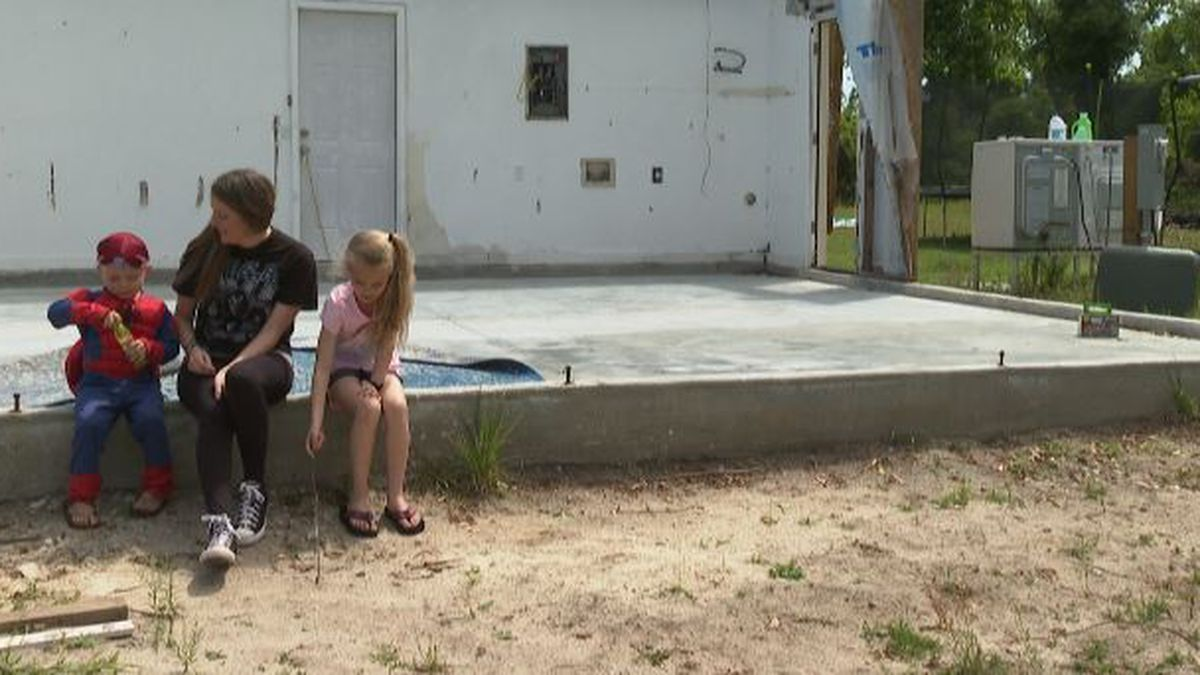 The family of five lives together in a camper alongside their house. (WJHG/WECP)