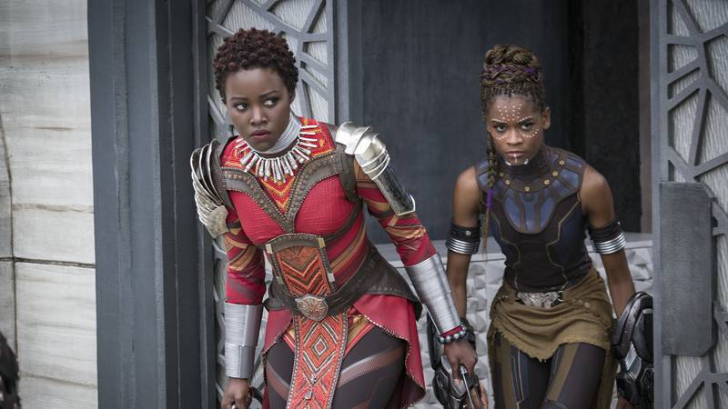 This image released by Disney shows Lupita Nyong'o, left, and Letitia Wright in a scene from...