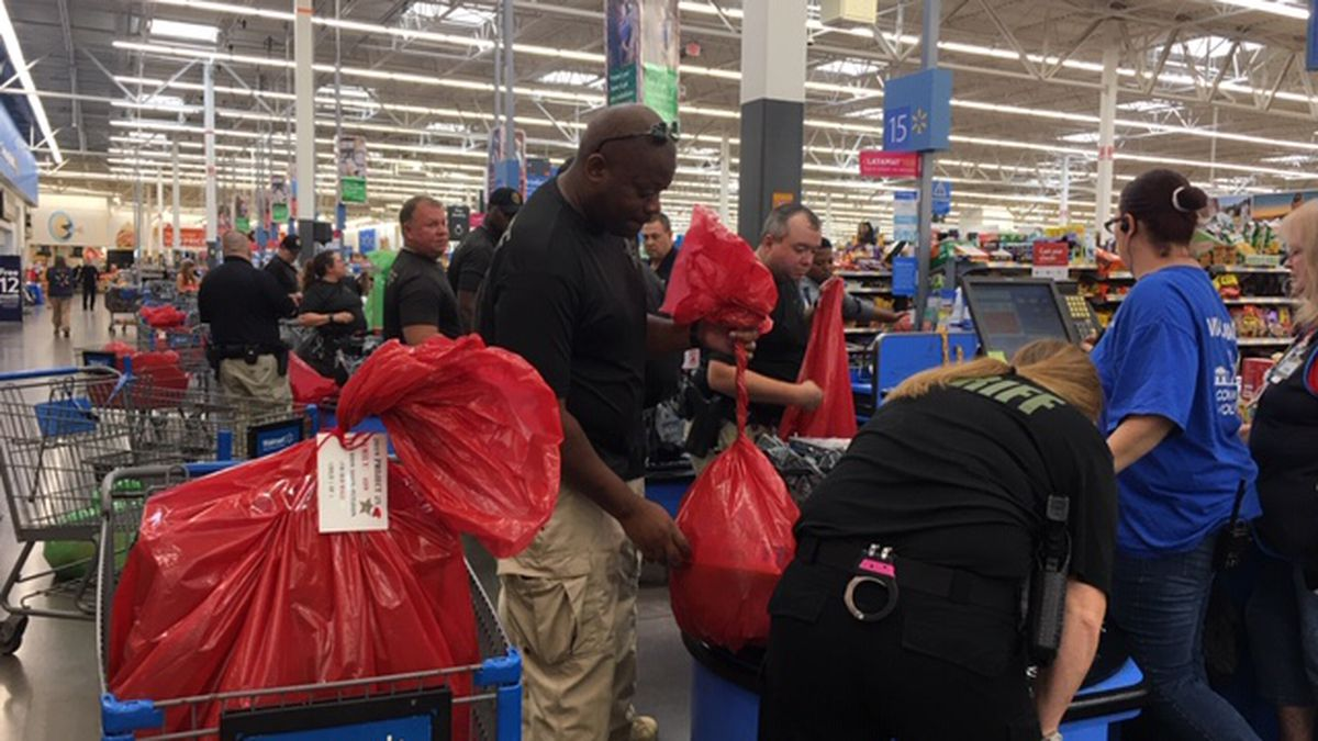 Bay County Sheriff's deputies and other volunteers are shopping for Project 25. This year they are shopping for around 1,300 children in need. (WJHG/WECP)