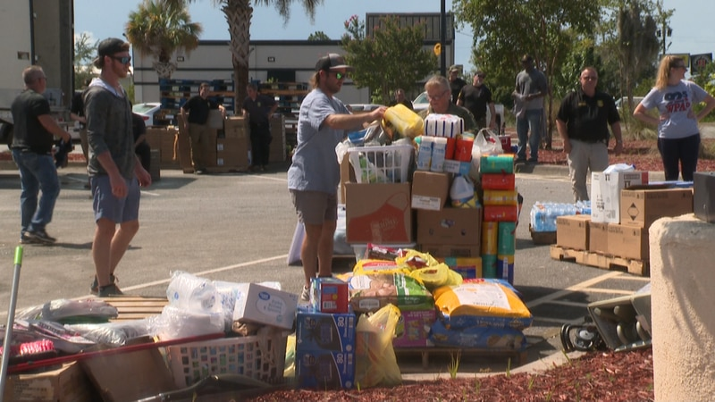 Three big semi-trucks parked outside the Lynn Haven Walmart were being stuffed to the brim. The...