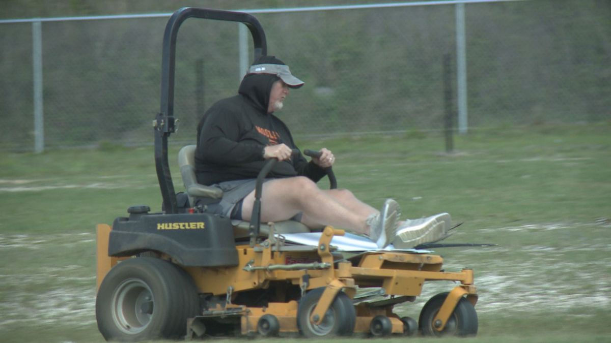 Mosley football coach Jeremy Brown still working on the field, and working with his players as best he can.
