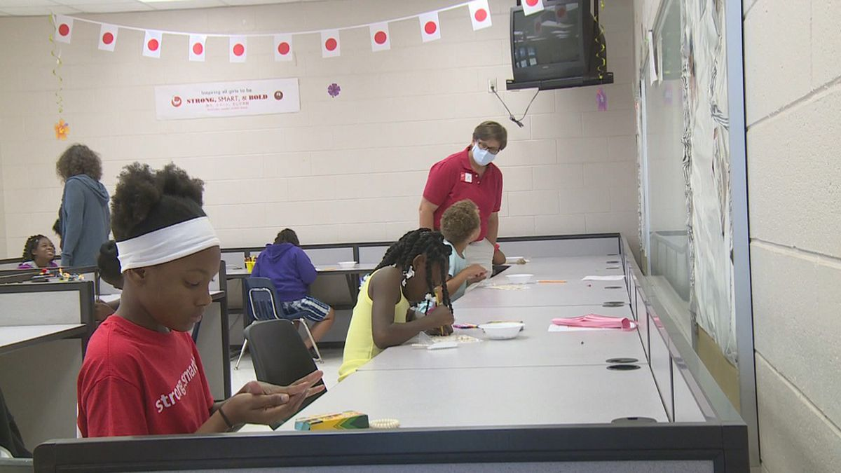 Girls are making arts and crafts while at Girls Inc. summer camp (WJHG).