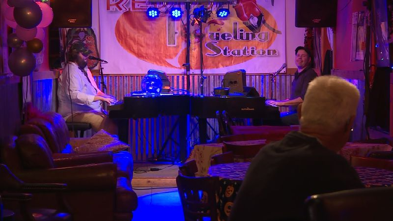 David Butler (left) and Nate Sangsland (right) duel it out on pianos at Redd's Fueling Station...