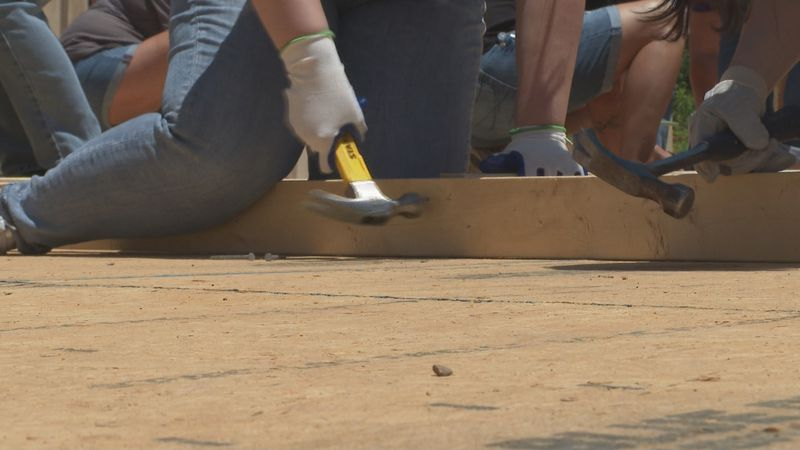 Habitat for Humanity helps a woman achieve her dream of home ownership.