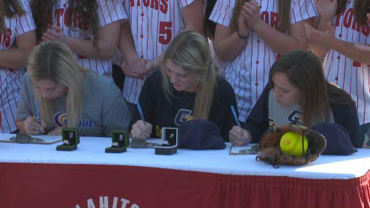 WHS seniors Savannah Lister, Gracie Price, and Cyrina Madrid sign college scholarships.