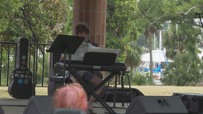 Students play music in McKenzie Park.