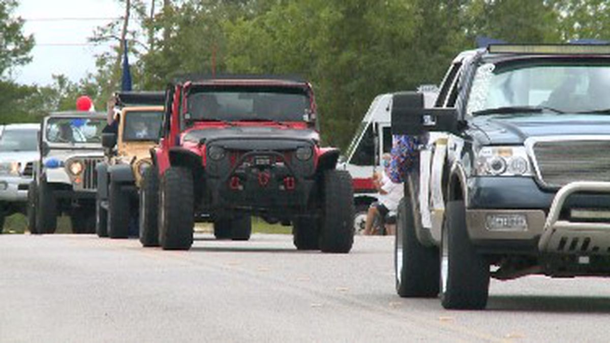 Students got in their cars where community and family members cheered them on. (WJHG/WECP)