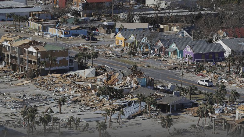 FILE - In this Oct. 12, 2018 file photo debris from homes destroyed by Hurricane Michael...