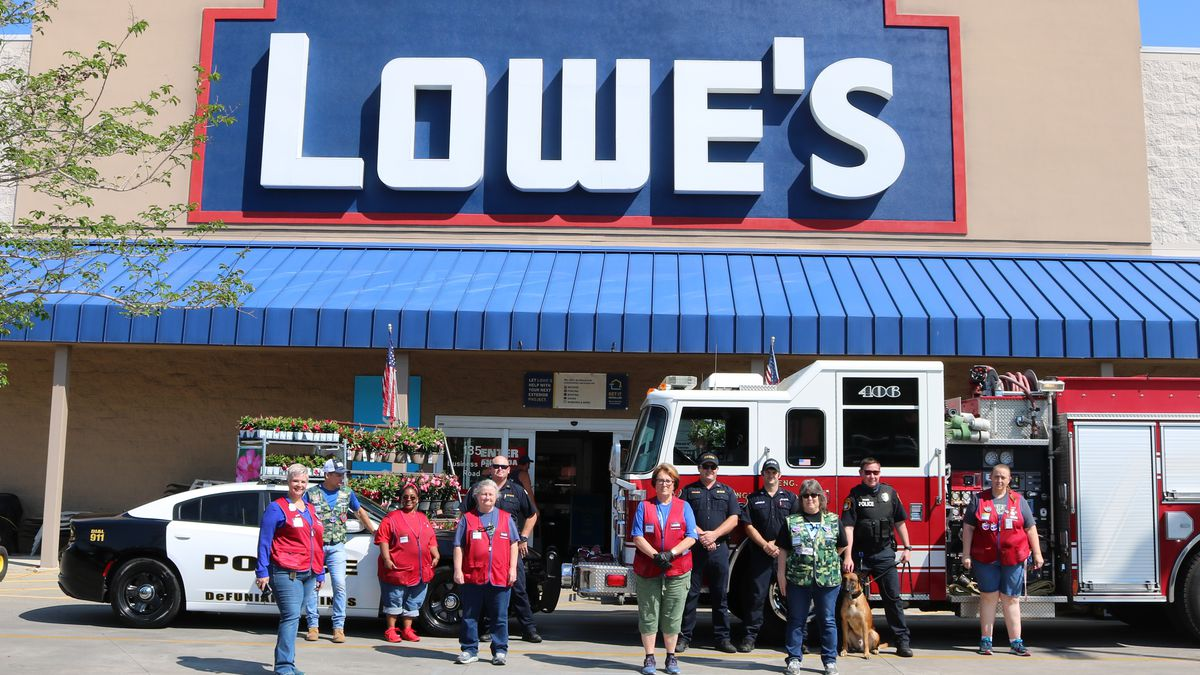 Lowe's management and associates join firefighters and police from DeFuniak Springs following contribution of building supplies. (Christopher Mitchell, City of DeFuniak Springs)