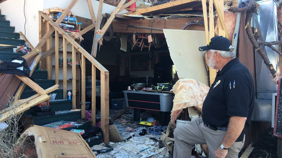 Mike Jones, best known as 'Salvage Santa', looks over what remains of his home in Panama City following Hurricane Michael.