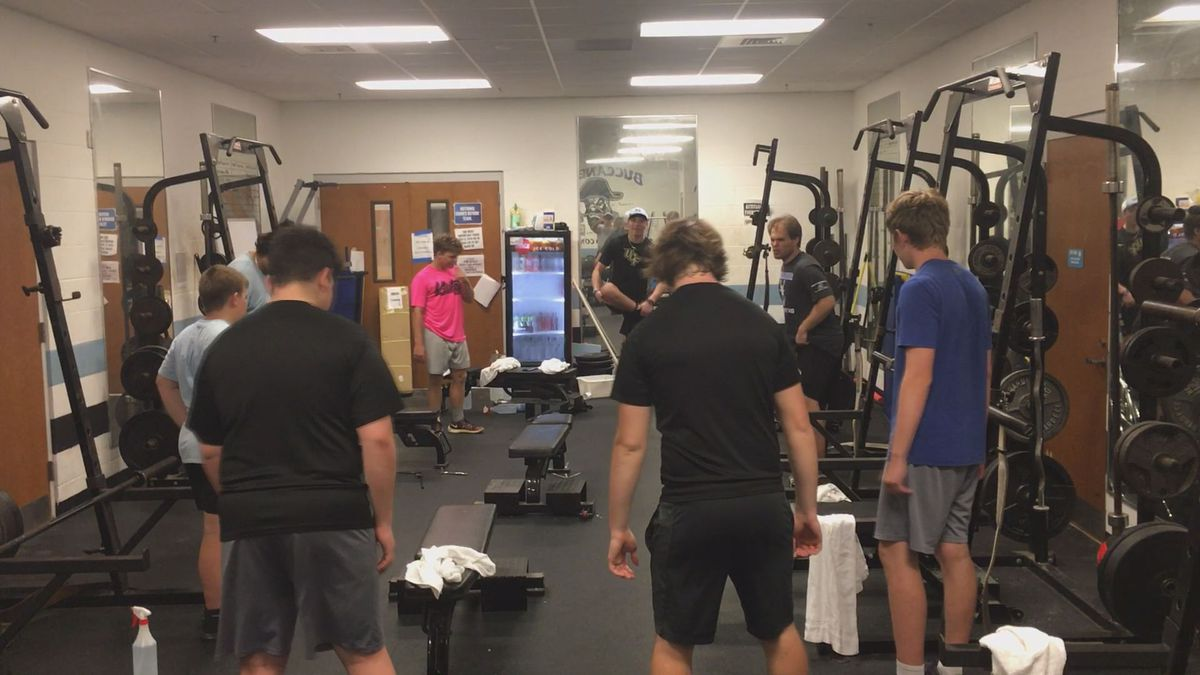 NBH football players back to work on campus