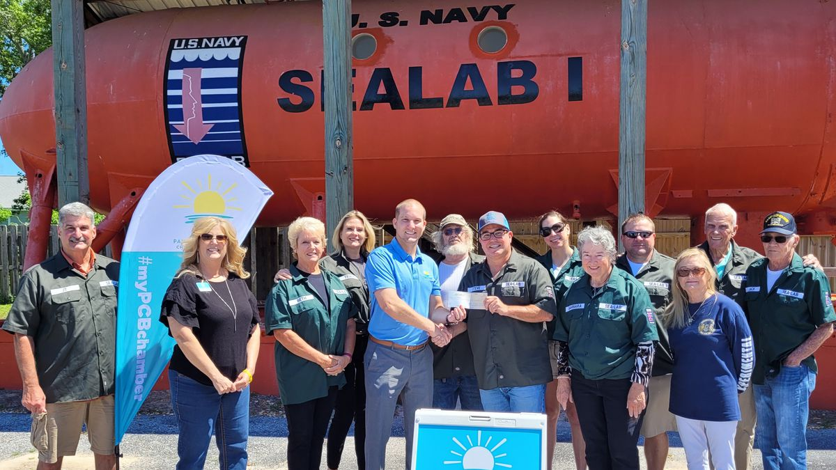 Panama City Beach Chamber of Commerce presented Man in the Sea Museum with a $1,000 donation...