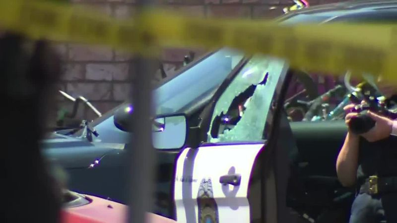 A shot-out police SUV window could be seen as crime scene investigators spent the day...