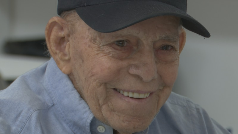 Clarence Gravely enjoys playing checkers and sharing about his time in the military while at...